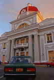 A classic car in front of an interesting building at Plaza Jose Marti Cuba during sunset Stock Photos