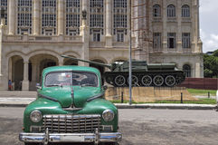 Classic car in front of the Presidential Palace in Havana, Cuba. Green american vintage car parked in front of the former Presidential Palace in Havana, Cuba royalty free stock photo