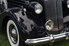 Classic car front side. Front of a classic gangster car with headlight and fender Stock Photo