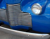 Classic car grill. Close-up of grill and headlight from a classic automobile stock photos