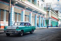 Classic Car on a Havana Street. A turquoise classic american car drives down a street in Havana, Cuba Royalty Free Stock Photography