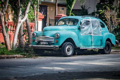 Classic Car on a Havana Street. A turquoise classic car missing windows sits parked on a street in Havana, Cuba Royalty Free Stock Photography