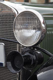 Classic car headlight. A close up detail shot of the left headlight of an old classic car royalty free stock photography