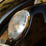 Classic car headlight. Close up detail of a classic vintage car Stock Photography