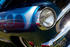 Classic Car Headlight and Fender. A closeup of the headlight and front bumper on a vintage car Stock Images