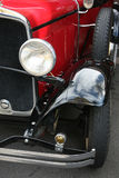 Classic car headlights. In silver and red stock images
