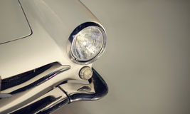 Classic car with headlights. On dark background royalty free stock photography