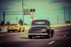 Classic car on highway royalty free stock image