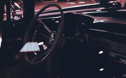 Classic Car Interior Showing Wooden Steering Wheel royalty free stock photos