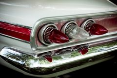 Classic car lights. Details of classic car brake lights and bumper royalty free stock photography