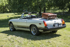 Classic car with luggage rack. Concours délégance longueuil, canada - june 22, 2014 rear side view of classic mgb convertible with luggage rack during car show Stock Images