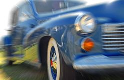 Classic Car with Motion Blur. Antique sedan turning corner with motion blur for speed effect Stock Photography
