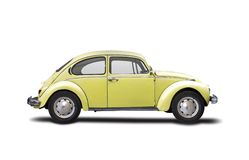 Classic car. Old yellow VW Beetle isolated on white Royalty Free Stock Photography