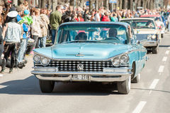 Classic car parade on May Day celebrates spring in Sweden Stock Photos