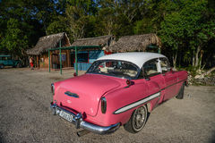 Classic car parked on beach in Matanzas,Cuba. Stock Images