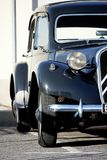 Classic car. Partial view of a black and classic car on the road Royalty Free Stock Photography