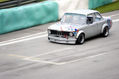 Classic Car Race. Classic car in racing action Royalty Free Stock Images