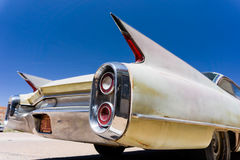 Classic car. Rear end of a classic American car with tail fins Stock Photos