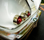 Classic car rear lights with rusty bumper. Selective focus Stock Photography