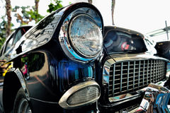 Classic car rear lights with rusty bumper. Selective focus Stock Image