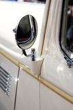 Classic car rear view mirror Royalty Free Stock Images