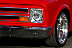 Classic Car in Red. A tight shot of an old classic chevy showing only part of the front grill and side of the car. Nice graphic lines and bright colors Royalty Free Stock Images