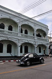 Classic car and Sino-Portugese building. Classic car and traditional Sino-Portugese building in Phuket town, Thailand stock image