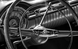 Classic Car Steering Wheel. Black & White Classic Car Steering wheel and interior, GM Stock Images