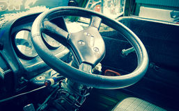 Classic car steering wheel and dash, Vintage Color toned image Royalty Free Stock Images