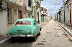 Classic Car on the Street in Cuba. Street in Cuban city of Camagüey with rare Classic Car Stock Photos