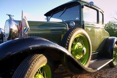 Classic car in the sun. A green classic car in the sun Stock Image