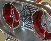 Classic Car Tail Lights Chrome Reflection. Classic car tail lights in a Chrome finish with a beautiful reflection of the lines in the background royalty free stock photography