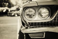 Classic car tail lights close-up. Classic car with chrome parts tail lights close-up royalty free stock photography