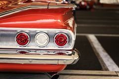 Classic car tail lights close-up. Classic car with chrome parts tail lights close-up royalty free stock photo