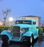 Classic car. Teal blue classic car, sun setting, car show, rainy night, old Royalty Free Stock Image