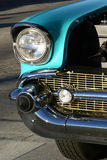 Classic Car Turquoise. Here's a beautiful American classic car decked out in chrome, turquoise paint and a gold grill. Great for stock, classic car applications Royalty Free Stock Photos