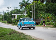 Classic car under way in the countryside from Cuba Royalty Free Stock Photo