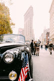 Classic car for Veterans Day Parade in front of the Flatiron building Stock Photography
