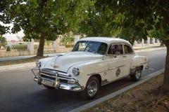 1952 Classic car. White 1952 classic taxi in Havana,Cuba Stock Photography