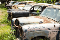 Classic car wreck at a junkyard Stock Photos