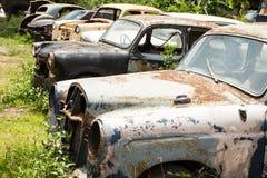Classic car wreck at a junkyard Stock Photos
