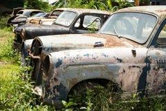 Classic car wreck at a junkyard Stock Images