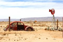 Rusty retro car Volkswagen Beetle decay desert, Namibia Royalty Free Stock Images