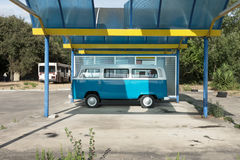 Classic caravan. German old blue transporter. Parked stock photos