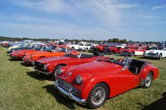 Classic Cars. WEST SUSSEX, ENGLAND. SEPTEMBER 2012: Classic sports cars including Triumph TR3 and TR6, Porsche and Jaguar parked at the Goodwood Revival festival Royalty Free Stock Photo