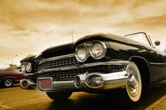 Classic Cars. Against cloudy sky in sepia color tone Stock Photography