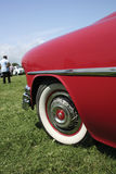Classic Cars - Choker. Classic/vintage car rally, front profile of red choker with alloy wheel royalty free stock photo