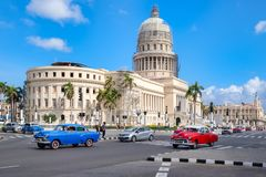 Classic cars in downtown Havana near the iconic Capitol building Stock Photos
