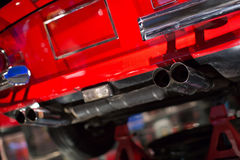 Classic cars. Exhaust pipe close-up of the first part of Stock Images