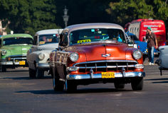 Classic cars in Havana.Cubans Stock Photos
